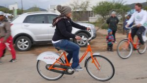 Beneficiary-of-Breede-Center-hops-on-newly-donated-bike-to-join-the-others-for-a-casual-ride-through-town