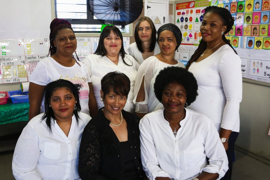 MathMoms (in white) with the MathMentor and director at Valhalla Primary. From left to right. Standing: Susanne Blou, Chevonne Groenemeyer (both completed ECD Courses at Northlink College at the end of 2020), Marlene Batt (found permanent employment), Maria Amram and Laurance Mtambo. Seated: Denise Sauls (MomMentor), Bertha Losper (MathMentor and Director) and Nene Omena.